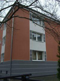 Häuserfassade mit grauen Balken Hugo Groll Malerbetrieb Bochum